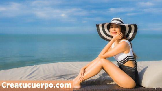 como cuidar el pelo en verano, protege tu cabello con un pañuelo o una gorra
